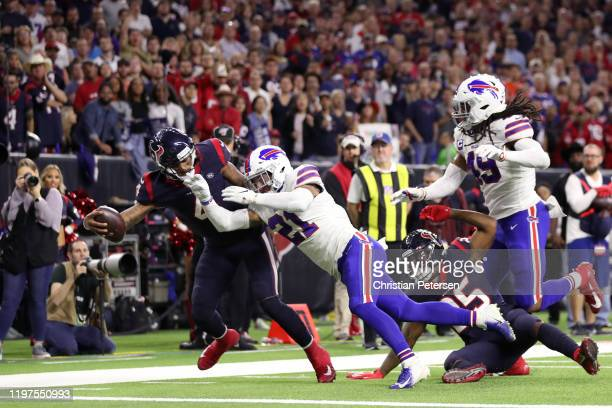 Deshaun Watson of the Houston Texans dives for a two point conversion against Jordan Poyer the Buffalo Bills during the third quarter during the...