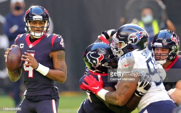 Deshaun Watson of the Houston Texans drops back to pass during the first half against the Tennessee Titans at NRG Stadium on January 03, 2021 in...