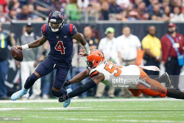 Deshaun Watson of the Houston Texans escapes a tackle by Chris Smith of the Cleveland Browns in the second quarter at NRG Stadium on December 2, 2018...