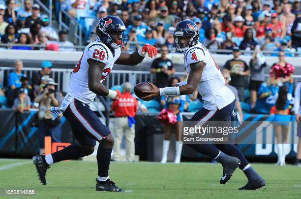 Deshaun Watson of the Houston Texans hands the ball off to Alfred Blue during the game against the Jacksonville Jaguars at TIAA Bank Field on October...