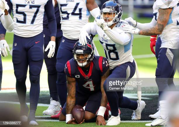 Deshaun Watson of the Houston Texans is brought down by Harold Landry of the Tennessee Titans during the first half at NRG Stadium on January 03,...