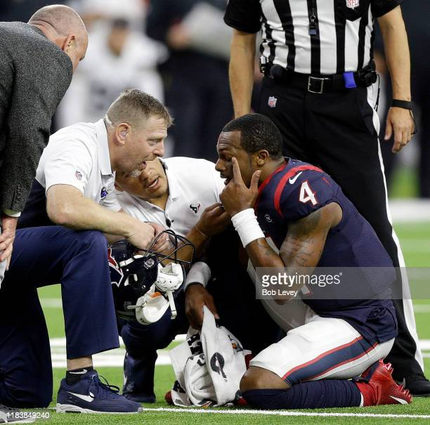 Deshaun Watson of the Houston Texans is looked at by the Houston Texans medical team after he suffered an injury to his left eye against the Oakland...