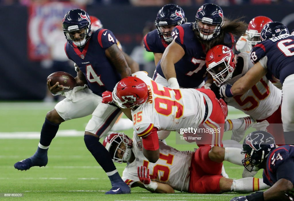 Deshaun Watson #4 of the Houston Texans is sacked by Frank Zombo #51 of the Kansas City Chiefs and Chris Jones #95 in the second quarter at NRG Stadium on October 8, 2017 in Houston, Texas.