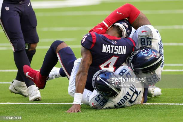 Deshaun Watson of the Houston Texans is sacked by Harold Landry of the Tennessee Titans during the first half at NRG Stadium on January 03, 2021 in...