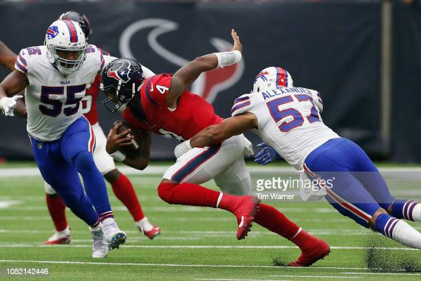 Deshaun Watson of the Houston Texans is sacked by Lorenzo Alexander of the Buffalo Bills in the fourth quarter at NRG Stadium on October 14 2018 in...