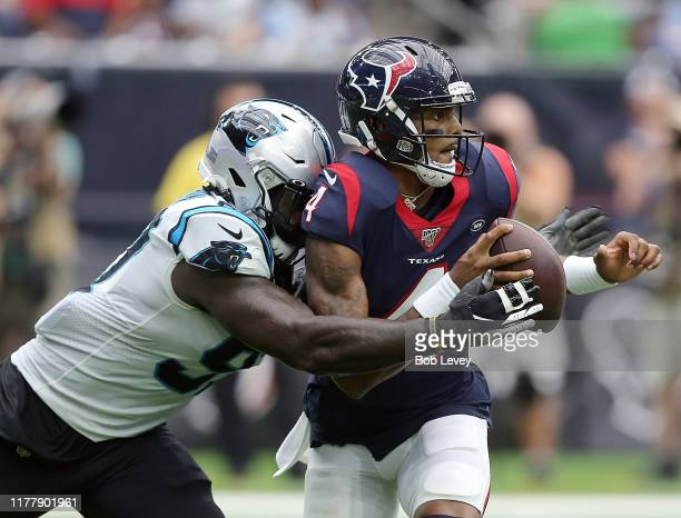 Deshaun Watson of the Houston Texans is sacked by Mario Addison of the Carolina Panthers during the first half at NRG Stadium on September 29, 2019...