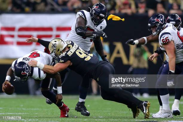 Deshaun Watson of the Houston Texans is sacked by Trey Hendrickson of the New Orleans Saints during the second half of a game at the Mercedes Benz...