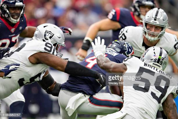 Deshaun Watson of the Houston Texans is tackled by Benson Mayowa of the Oakland Raiders at NRG Stadium on October 27, 2019 in Houston, Texas. The...