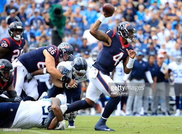 Deshaun Watson of the Houston Texans is tackled by Jurrell Casey of the Tennessee Titans at Nissan Stadium on September 16 2018 in Nashville Tennessee