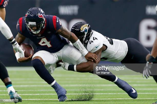Deshaun Watson of the Houston Texans is tackled by Myles Jack of the Jacksonville Jaguars in the first quarter at NRG Stadium on December 30, 2018 in...