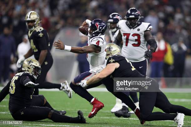 Deshaun Watson of the Houston Texans is tackled by Ryan Ramczyk of the New Orleans Saints at Mercedes Benz Superdome on September 09, 2019 in New...