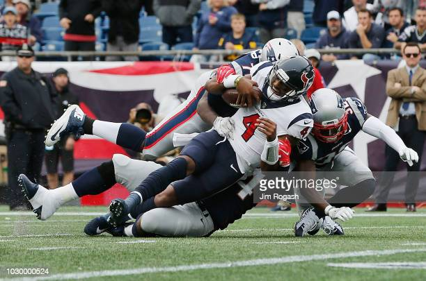 Deshaun Watson of the Houston Texans is tackled by the New England Patriots defense during the second half at Gillette Stadium on September 9 2018 in...