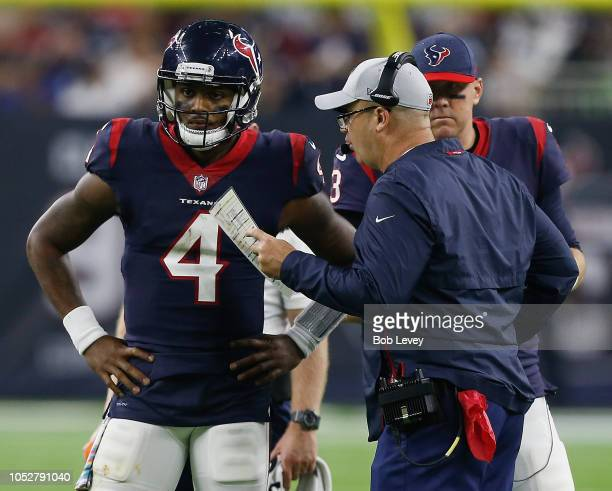 Deshaun Watson of the Houston Texans listens to instructions from head coach Bill O'Brien of the Houston Texans as Brandon Weeden listens in against...