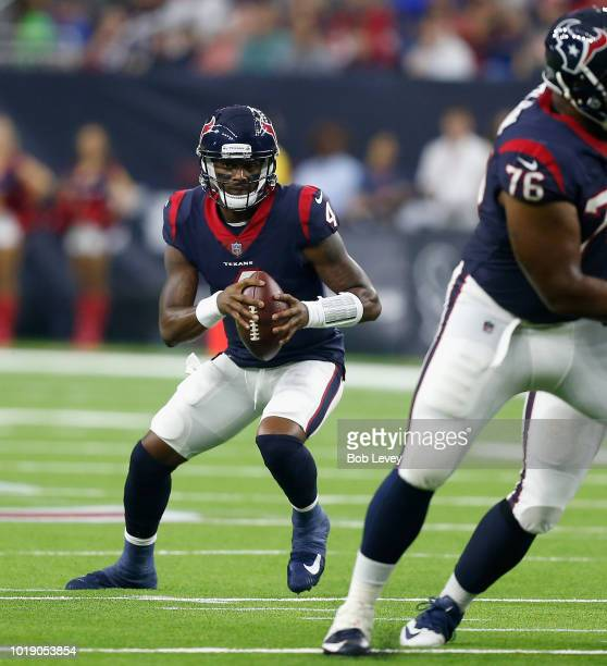 Deshaun Watson of the Houston Texans looks for space to run against the San Francisco 49ers in the first half during a preseason game at NRG Stadium...