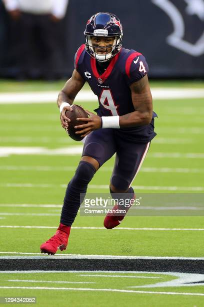 Deshaun Watson of the Houston Texans looks to pass during the first half against the Tennessee Titans at NRG Stadium on January 03, 2021 in Houston,...
