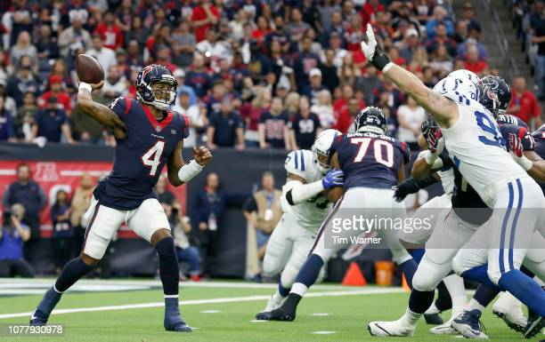 Deshaun Watson of the Houston Texans looks to pass under pressure by Margus Hunt of the Indianapolis Colts in the second quarter during the Wild Card...