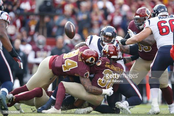 Deshaun Watson of the Houston Texans loses the ball while trying to pass in the second quarter of the game against the Washington Redskins at...