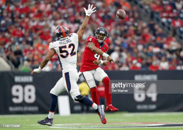 Deshaun Watson of the Houston Texans passes the ball as he is pressured by Justin Hollins of the Denver Broncos in the second quarter at NRG Stadium...