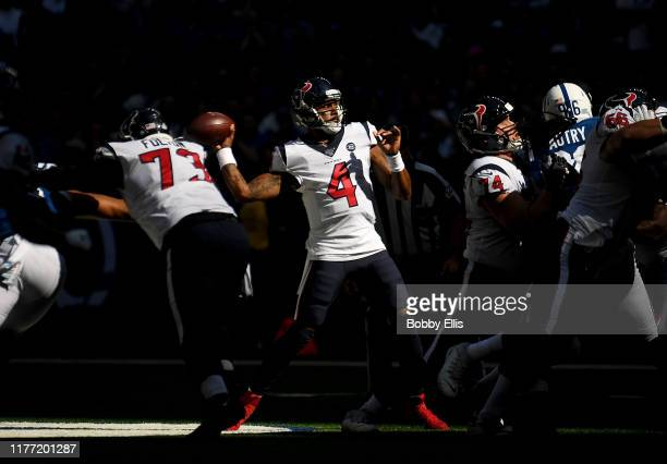 Deshaun Watson of the Houston Texans passes the ball during the first quarter of the game against the Indianapolis Colts at Lucas Oil Stadium on...