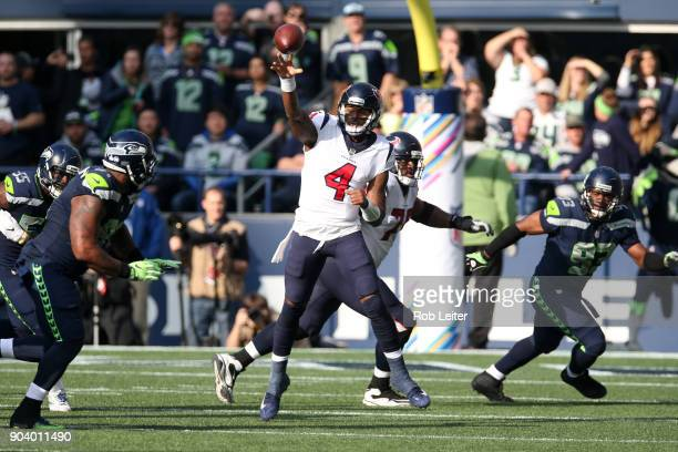 Deshaun Watson of the Houston Texans passes the ball during the game against the Seattle Seahawks at CenturyLink Field on October 29 2017 in Seattle...