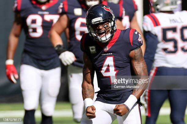Deshaun Watson of the Houston Texans reacts following a touchdown in the first quarter during their game against the New England Patriots at NRG...