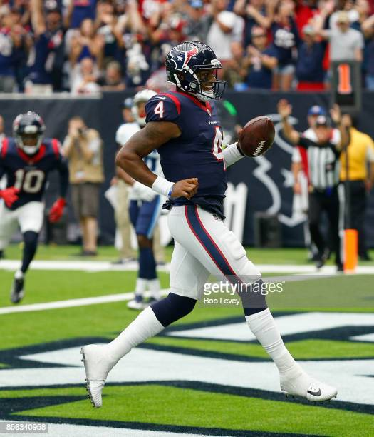 Deshaun Watson of the Houston Texans runs for a one yard touchdown in the second quarter against the Tennessee Titans at NRG Stadium on October 1...