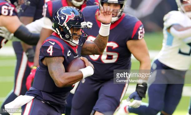 Deshaun Watson of the Houston Texans runs for yards during the first half against the Tennessee Titans at NRG Stadium on January 03, 2021 in Houston,...