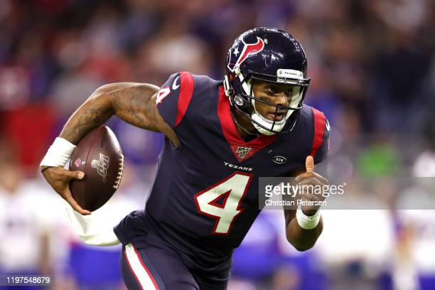 Deshaun Watson of the Houston Texans runs the ball for a touchdown against the Buffalo Bills during the third quarter of the AFC Wild Card Playoff...
