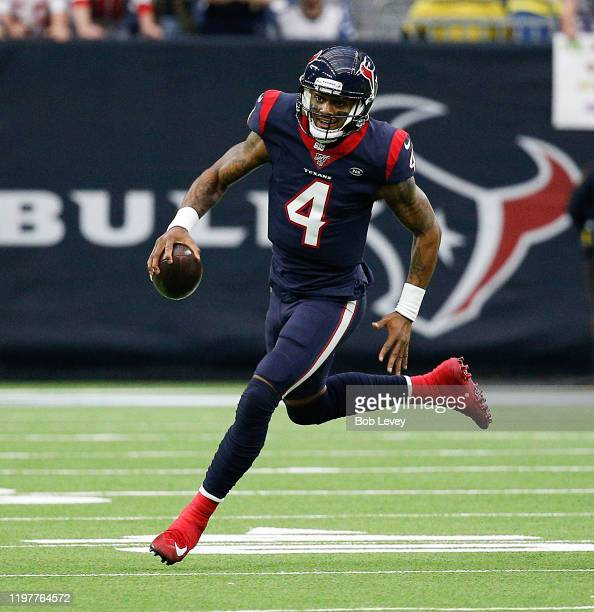 Deshaun Watson of the Houston Texans runs with the ball against the Buffalo Bills during the AFC Wild Card Playoff game at NRG Stadium on January 04...