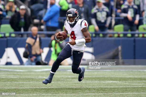 Deshaun Watson of the Houston Texans runs with the ball during the game against the Seattle Seahawks at CenturyLink Field on October 29 2017 in...