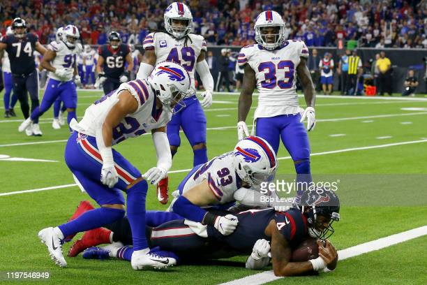 Deshaun Watson of the Houston Texans rushes for a touchdown against the Buffalo Bills during the third quarter of the AFC Wild Card Playoff game at...