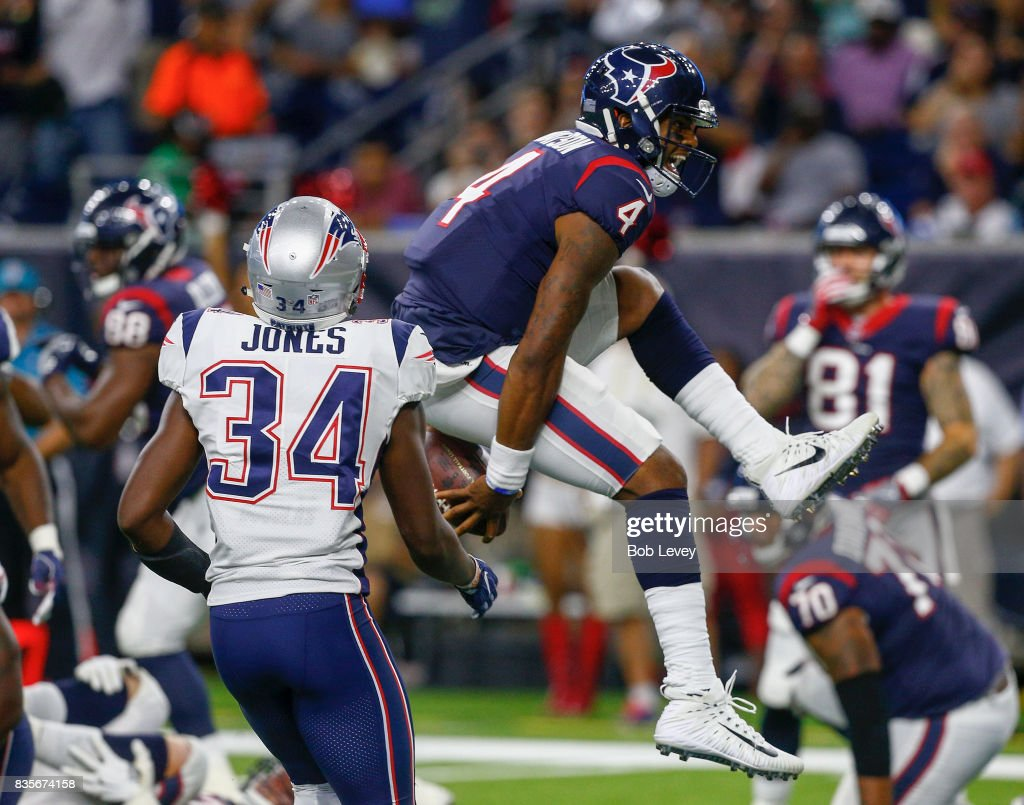 Deshaun Watson #4 of the Houston Texans rushes two yards for a touchdown past David Jones #34 of the New England Patriots in the third quarter at NRG Stadium on August 19, 2017 in Houston, Texas.