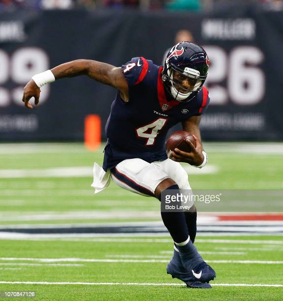 Deshaun Watson of the Houston Texans rushes with the ball against the Indianapolis Colts during the first quarter at NRG Stadium on December 9 2018...