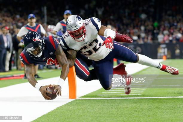 Deshaun Watson of the Houston Texans scores a touchdown against Elandon Roberts of the New England Patriots during the fourth quarter in the game at...