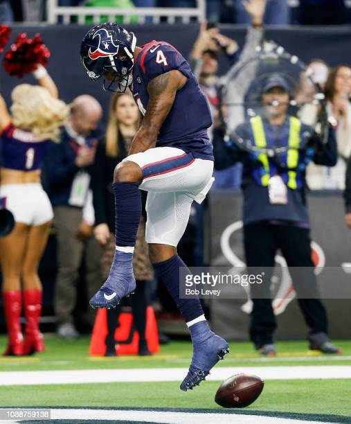 Deshaun Watson of the Houston Texans scores a touchdown against the Jacksonville Jaguars during the third quarter at NRG Stadium on December 30 2018...