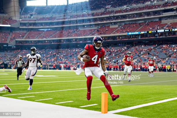 Deshaun Watson of the Houston Texans scores a touchdown during the second half of a game against the Denver Broncos at NRG Stadium on December 8,...