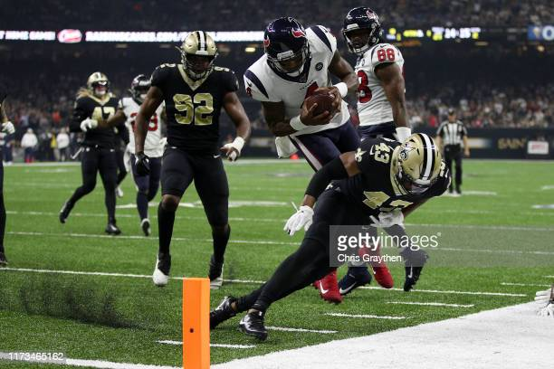 Deshaun Watson of the Houston Texans scores a touchdown over Marcus Williams of the New Orleans Saints in the second quarter at Mercedes Benz...