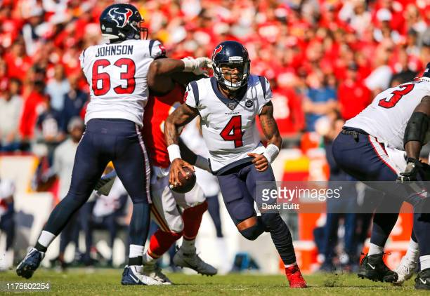 Deshaun Watson of the Houston Texans scrambles for yardage in the fourth quarter against the Kansas City Chiefs at Arrowhead Stadium on October 13...