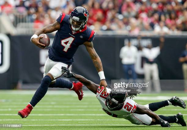 Deshaun Watson of the Houston Texans scrambles in the first half defended by Desmond Trufant of the Atlanta Falcons at NRG Stadium on October 6, 2019...