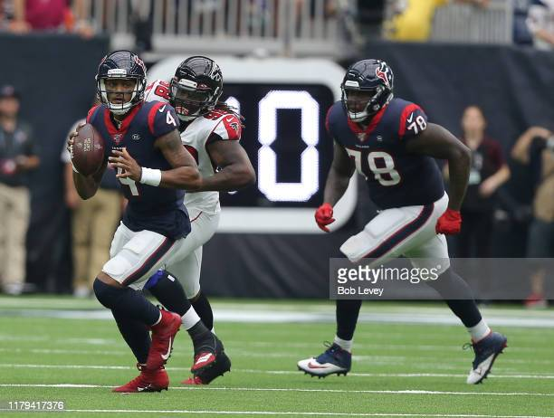 Deshaun Watson of the Houston Texans scrambles out of the pocket as Takkarist McKinley of the Atlanta Falcons pursues on the play wth Laremy Tunsil...