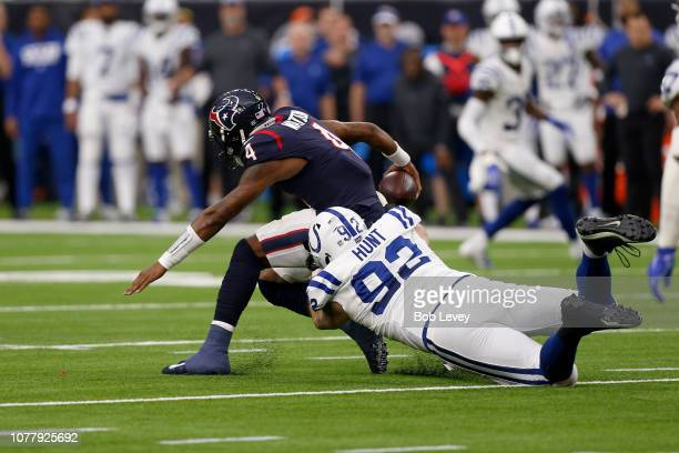 Deshaun Watson of the Houston Texans scrambles with the ball tackled by Margus Hunt of the Indianapolis Colts in the first quarter during the Wild...