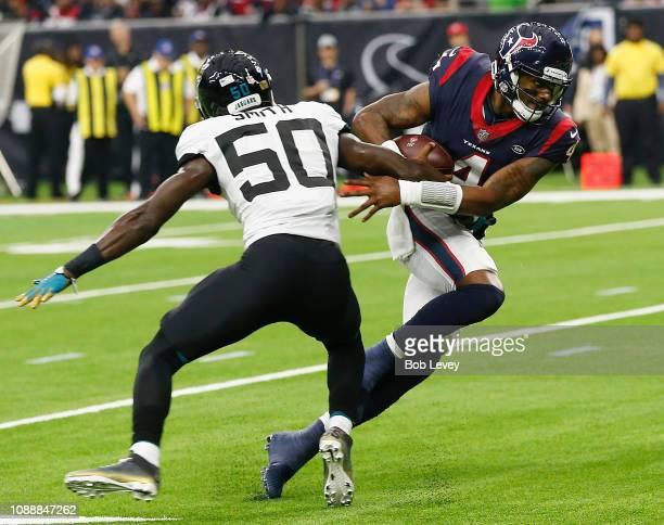 Deshaun Watson of the Houston Texans sidesteps Telvin Smith of the Jacksonville Jaguars at NRG Stadium on December 30 2018 in Houston Texas