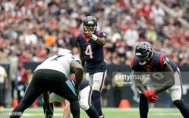 Deshaun Watson of the Houston Texans signals at the line of scrimmage in the first half against the Carolina Panthers at NRG Stadium on September 29...