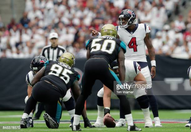 Deshaun Watson of the Houston Texans signals at the line of scrimmage in the third quarter against the Jacksonville Jaguars at NRG Stadium on...