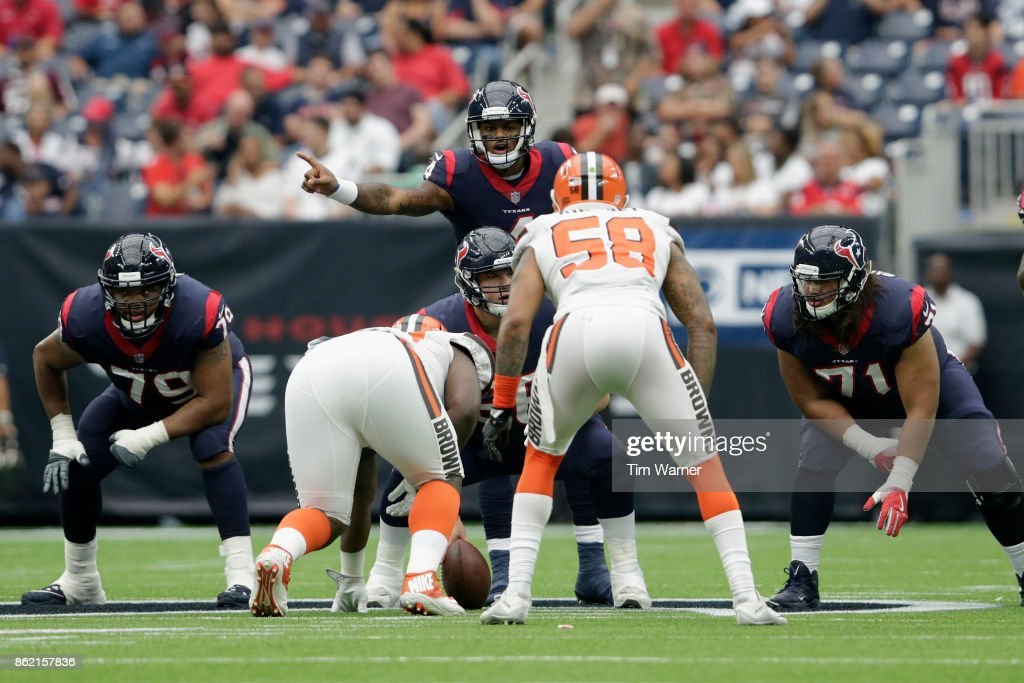 Deshaun Watson #4 of the Houston Texans signals at the line of scrimmage in the second quarter against the Cleveland Browns at NRG Stadium on October 15, 2017 in Houston, Texas.