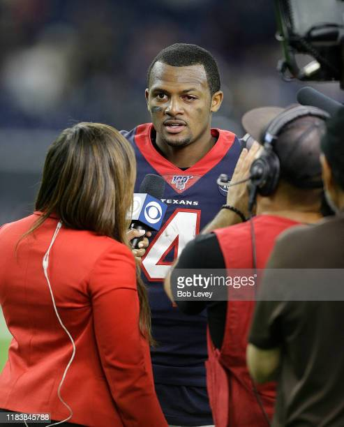 Deshaun Watson of the Houston Texans talks with a CBS reporter at the end of the game after defeating the Oakland Raiders 27-24 at NRG Stadium on...