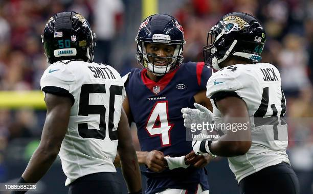 Deshaun Watson of the Houston Texans talks with Myles Jack of the Jacksonville Jaguars and Telvin Smith in the fourth quarter at NRG Stadium on...