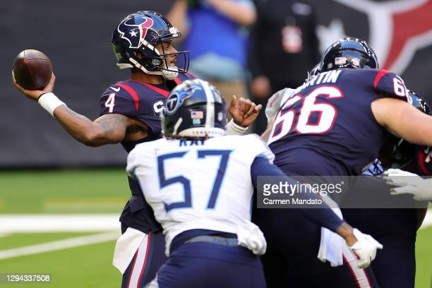 Deshaun Watson of the Houston Texans throws a pass during the first half against the Tennessee Titans at NRG Stadium on January 03, 2021 in Houston,...