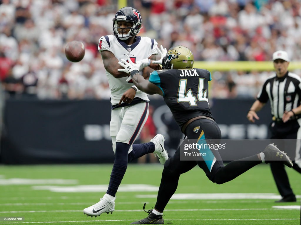 Deshaun Watson #4 of the Houston Texans throws a pass under pressure by Myles Jack #44 of the Jacksonville Jaguars in the third quarter at NRG Stadium on September 10, 2017 in Houston, Texas.