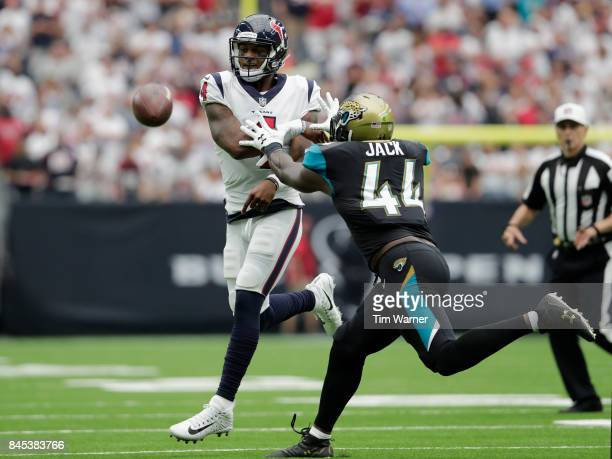 Deshaun Watson of the Houston Texans throws a pass under pressure by Myles Jack of the Jacksonville Jaguars in the third quarter at NRG Stadium on...